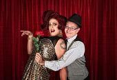 image of drag-queen  - Man in hat attracted to drag queen - JPG