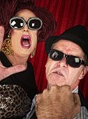 image of annoyance  - Annoyed famous couple with sunglasses on curtain background - JPG