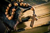 pic of rosary  - stack of old books with rosary beads - JPG