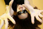image of hughes  - Beautyful woman with sunglasses isolated on orange background - JPG