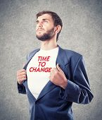 stock photo of motivational  - The beautiful young businessman motivates to change - JPG