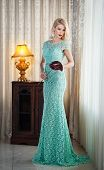 pic of lace-curtain  - Young beautiful luxurious woman in long elegant dress - JPG