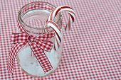 candy canes in canning jar