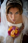 stock photo of wanton  - Bride with Bouquet Looking Up at Camera - JPG