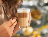 Closeup On Young Woman With Candy And Latte Macchiato