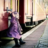 foto of child missing  - Little cute girl ready to vacation on railway station - JPG