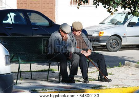 Two Spanish men on a bench, Spain.
