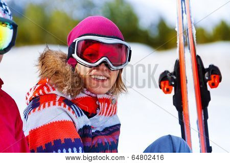 Happy girl in ski mask smiling