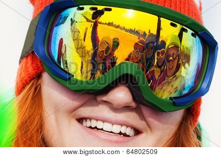 Smiling girl in ski mask with reflection