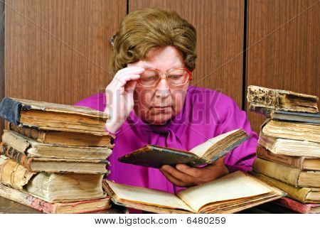 Old Woman In Library With Religious Books