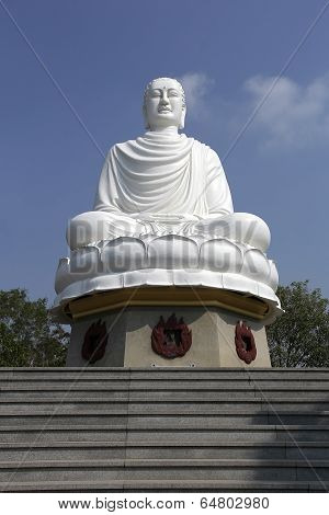 White Buddha Statue Sitting In Lotus Flower