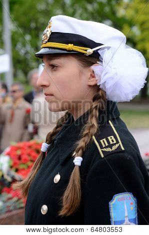Young girl in sailor uniform standing in guard of honour during ceremonial paradein Odessa,Ukraine