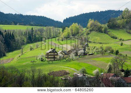 Idyllic rural view of gently rolling patchwork farmland