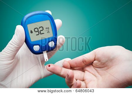 Doctor Making Blood Sugar Test. Hands With Gloves On Medical Background