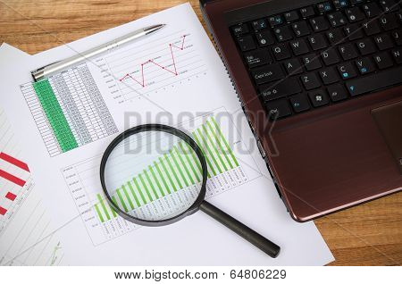 Magnifier On Business Wooden Background