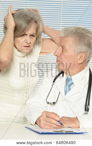 Elderly woman and doctor