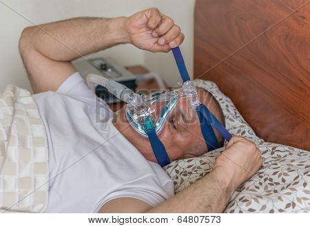 Obese Man Suffering From Sleep Apnea