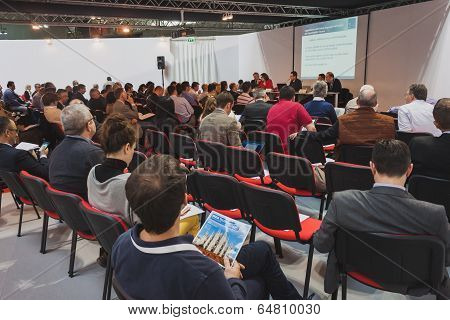 People Following A Conference At Solarexpo 2014 In Milan, Italy