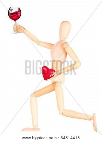 wooden Dummy with wine holding red heart