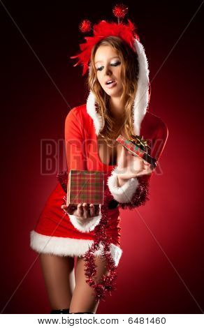 Young Sexy Woman In Santa Clothing