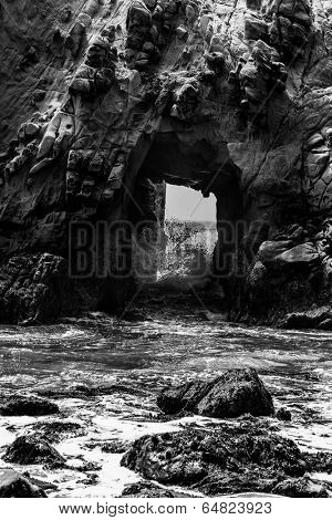 California Pfeiffer Beach in Big Sur State Park dramatic black and white rocks and waves