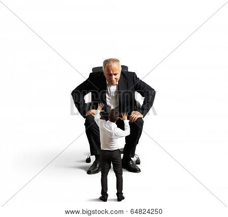 strict boss looking at small scared worker. isolated on white background