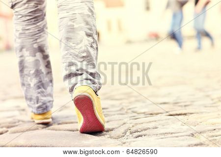 Picture of female legs on sett in a town