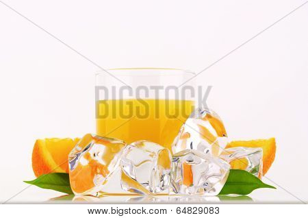glass of pure orange juice and frozen ice cubes