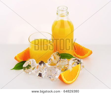fresh orange juice poured in the glass and bottle