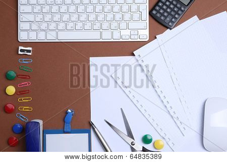 Office table with stationery accessories, keyboard and paper, close up