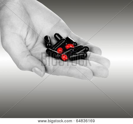 Drug abuse concept - hand holding pills