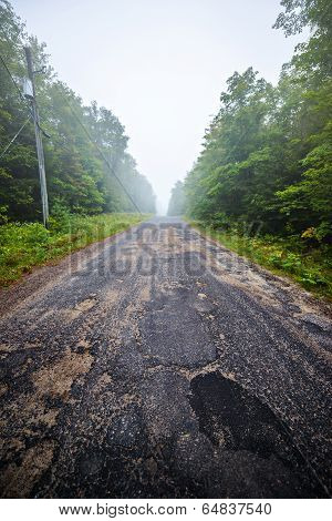 Potholes On A Country Road