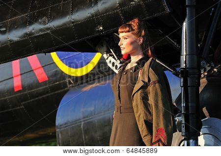Pretty Lady In Army Uniform With Wwii Bomber
