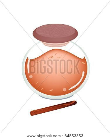 Jar Of Cinnamon Powder On White Background