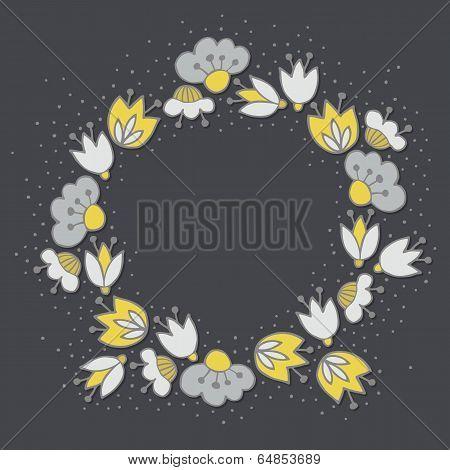 yellow gray flowers in round wreath on dark