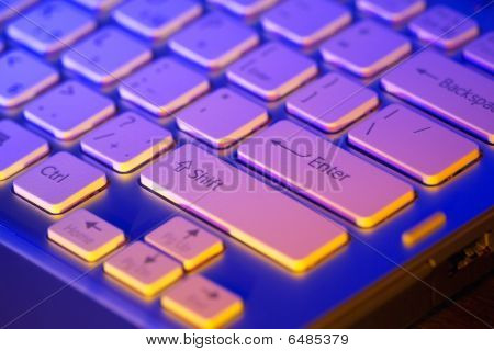 Keyboard of an open laptop. Closeup