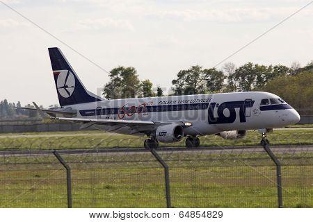 Landing LOT Polish Airlines Embraer ERJ175 aircraft