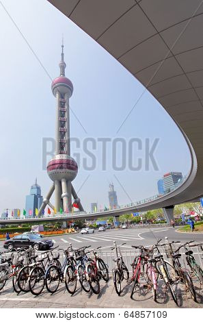 SHANGHAI, CHINA - APRIL 10, 2014: View of The Oriental Pearl Radio and TV Tower and Shanghai Lujiazui flyover