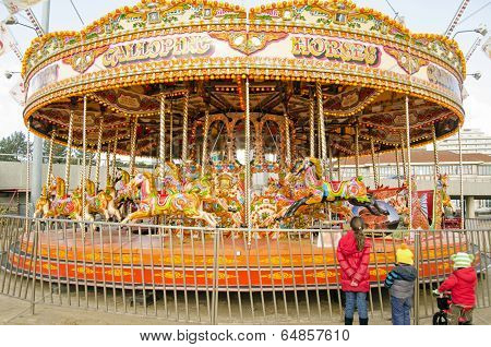 Children looking at Carousel