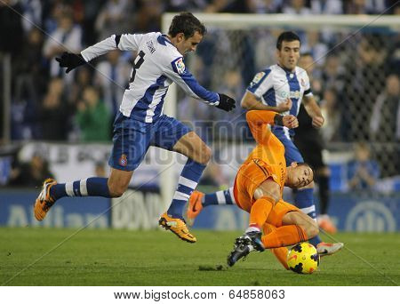 BARCELONA - JAN, 12: Cristiano Ronaldo(R) of Real Madrid vies with Stuani (L) of Espanyol  during the Spanish League match at the Estadi Cornella on January 12, 2014 in Barcelona, Spain