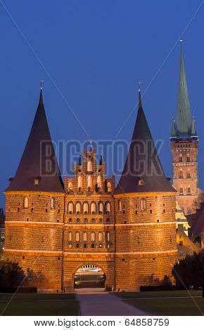 Holstein Gate And Petri Church By Night In Lubeck