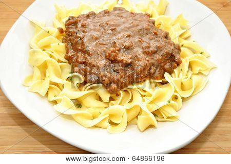 A Delicious Dish Of Noodles With Beef Gravy