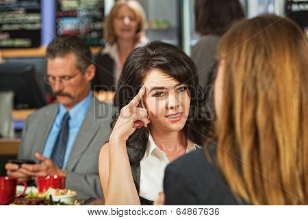 Skeptical Female In Cafe
