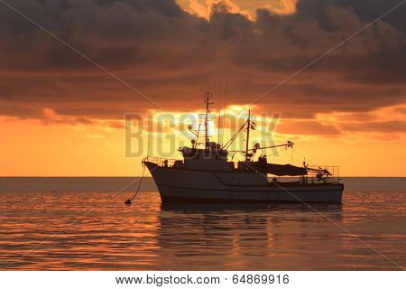 Fishing trawler at sunset