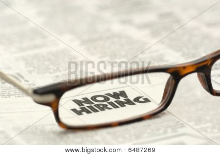 Now Hiring Classified Ad Framed In Glasses