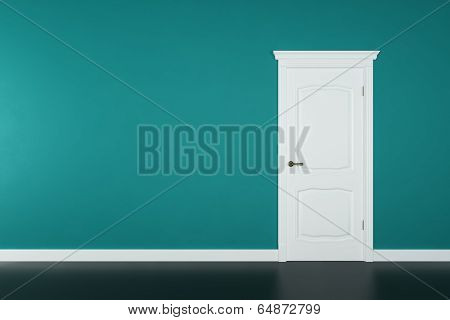 Closed white door on green wall