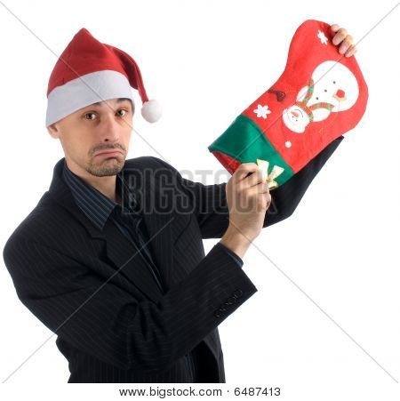Upset Businessman In A Christmas Hat