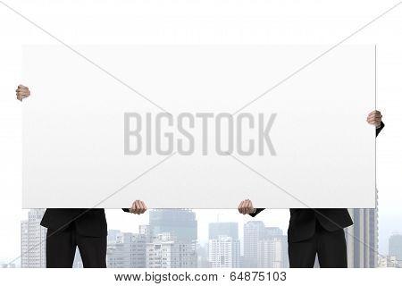 Two Businessmen Lift Board