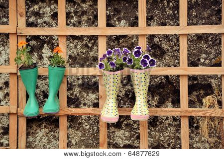 vegetation the art, flower bouquets in rubber boots