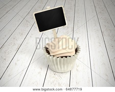 Gift Cupcake With Blank Chalkboard Signboard Label On White Wood